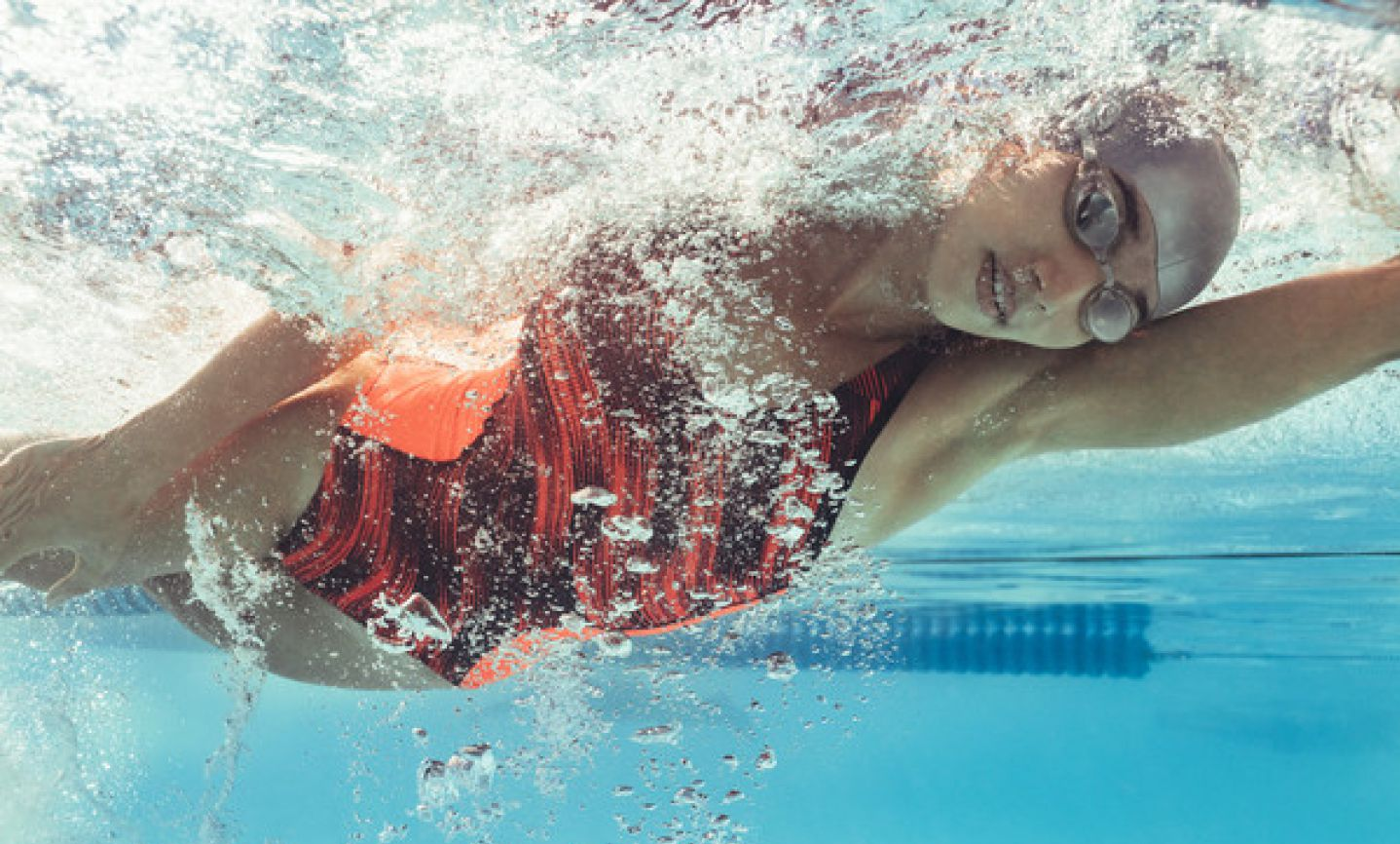 Photo of a female swimmer underwater