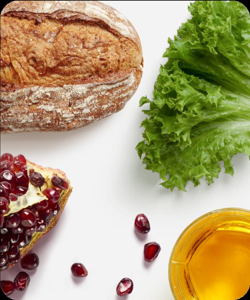 Assortment of foods, bread, vegetables, fruit, juice