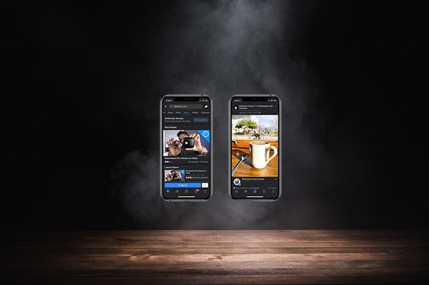 iPhones hovering in a smokey dark scene with what looks like a Facebook dark post on the screen.