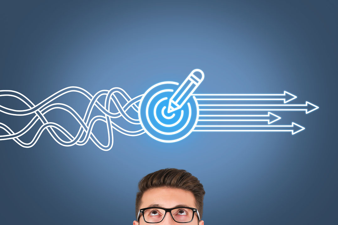 Man with glasses looking at squiggly lines that turn into straight arrows