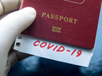 """Issue #111 - Image of passport with note reading """"Covid-19"""""""