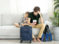 Issue #123 - Image of two upset children and travel luggage