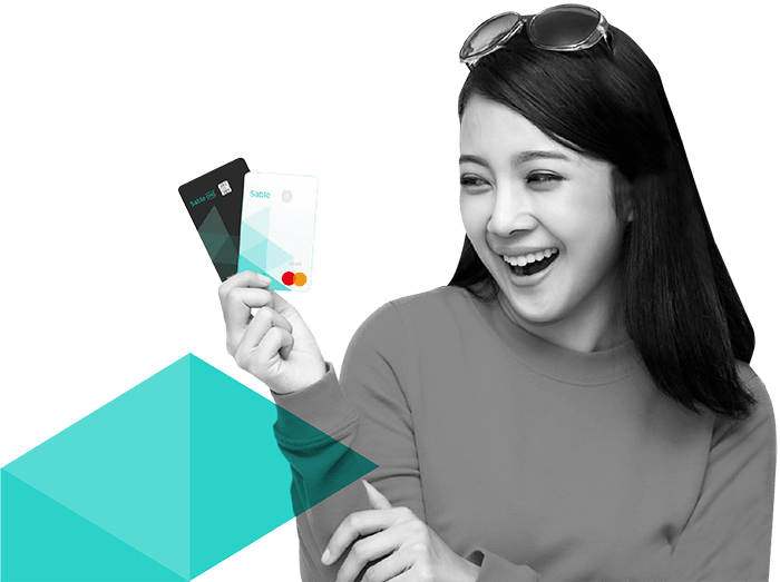 Happy woman holding sable cards