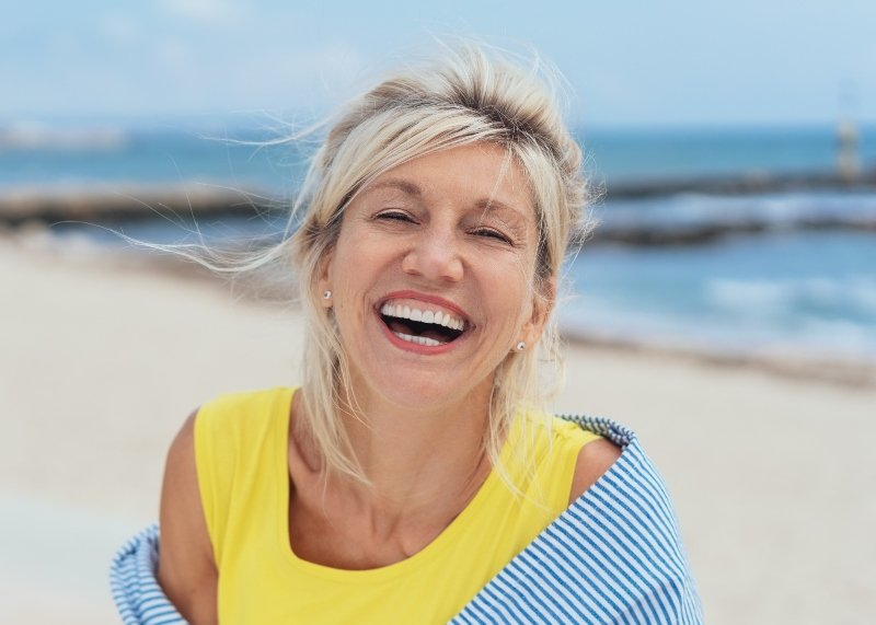 blonde woman smiling at the beach