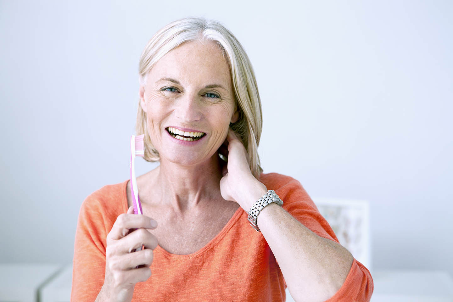 female patient holding a toothbrush