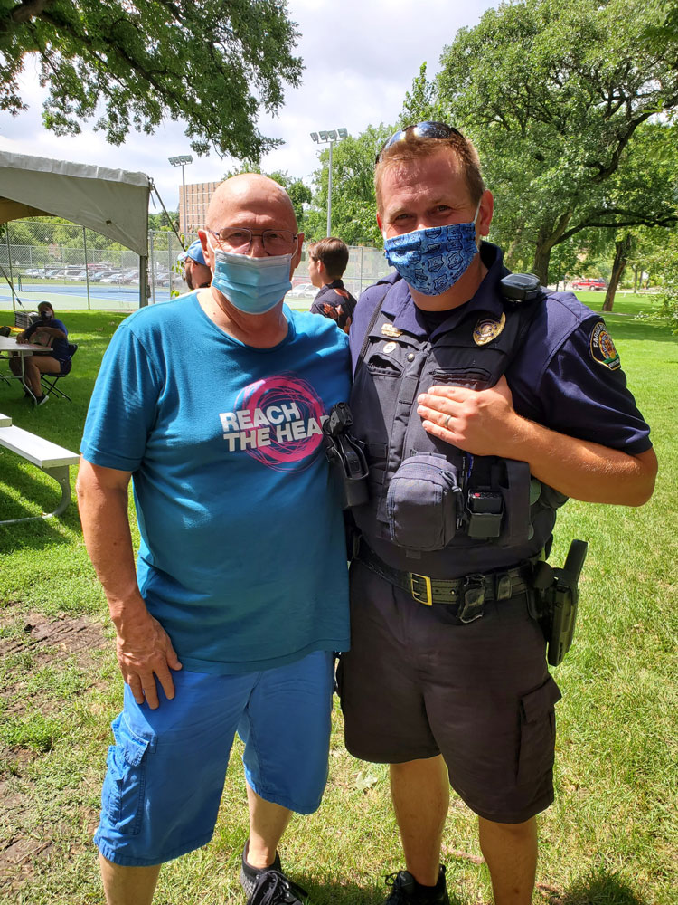 Pastor Cal and a Fargo Community Trust Officer