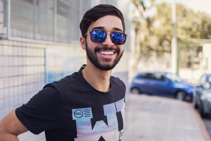 man wearing sunglasses smiling