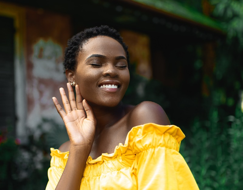 woman in yellow dress smiling
