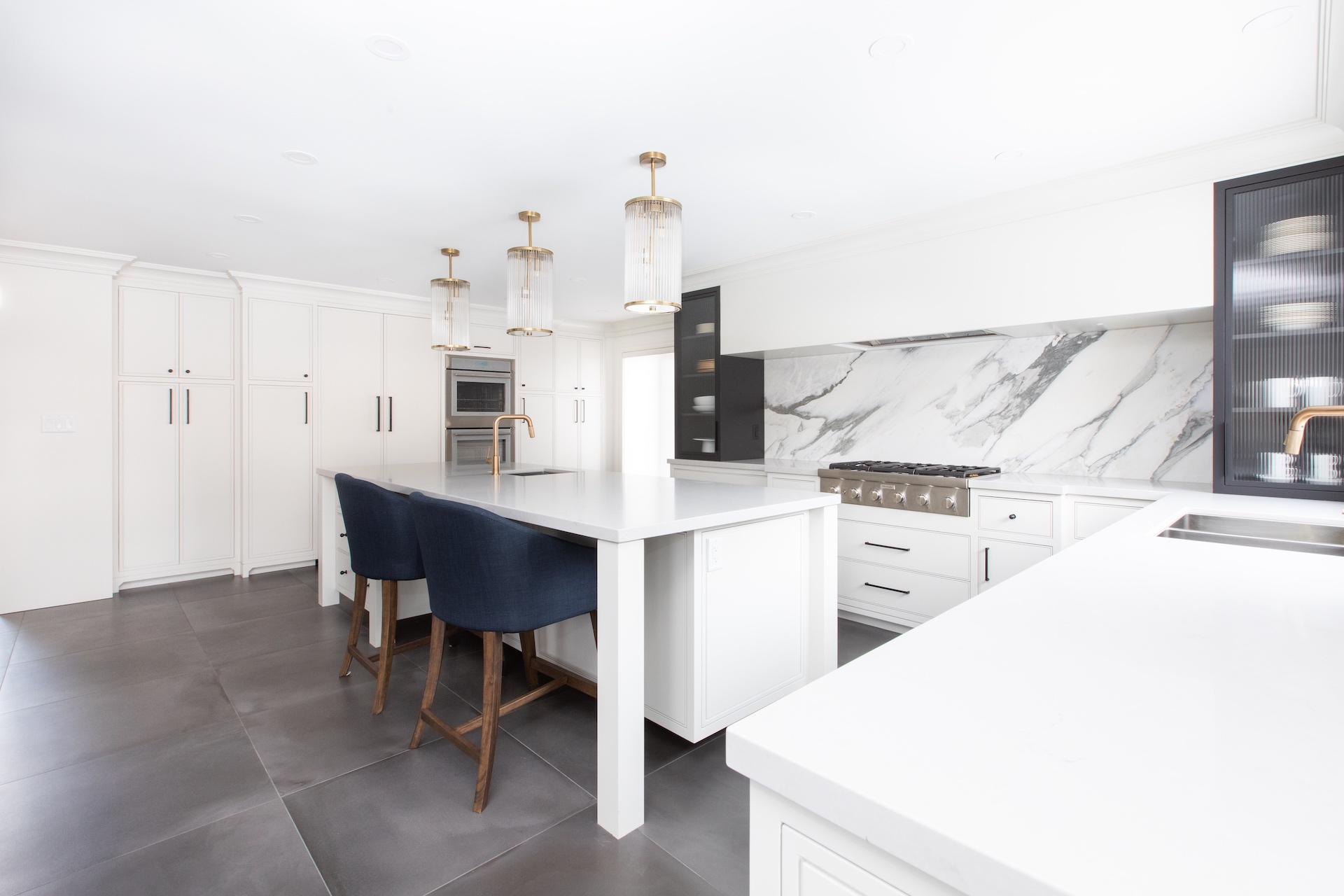White NIICO Kitchen with blue bar stools