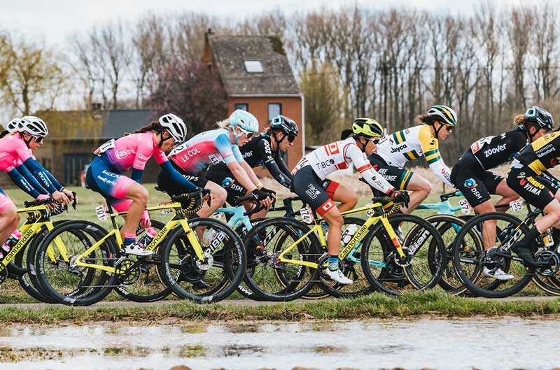 Female Athletes Racing in a Peloton