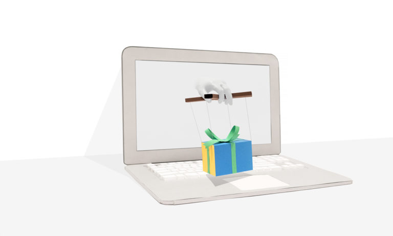 Laptop with hand emerging from the screen holding a gift box held by puppet strings.