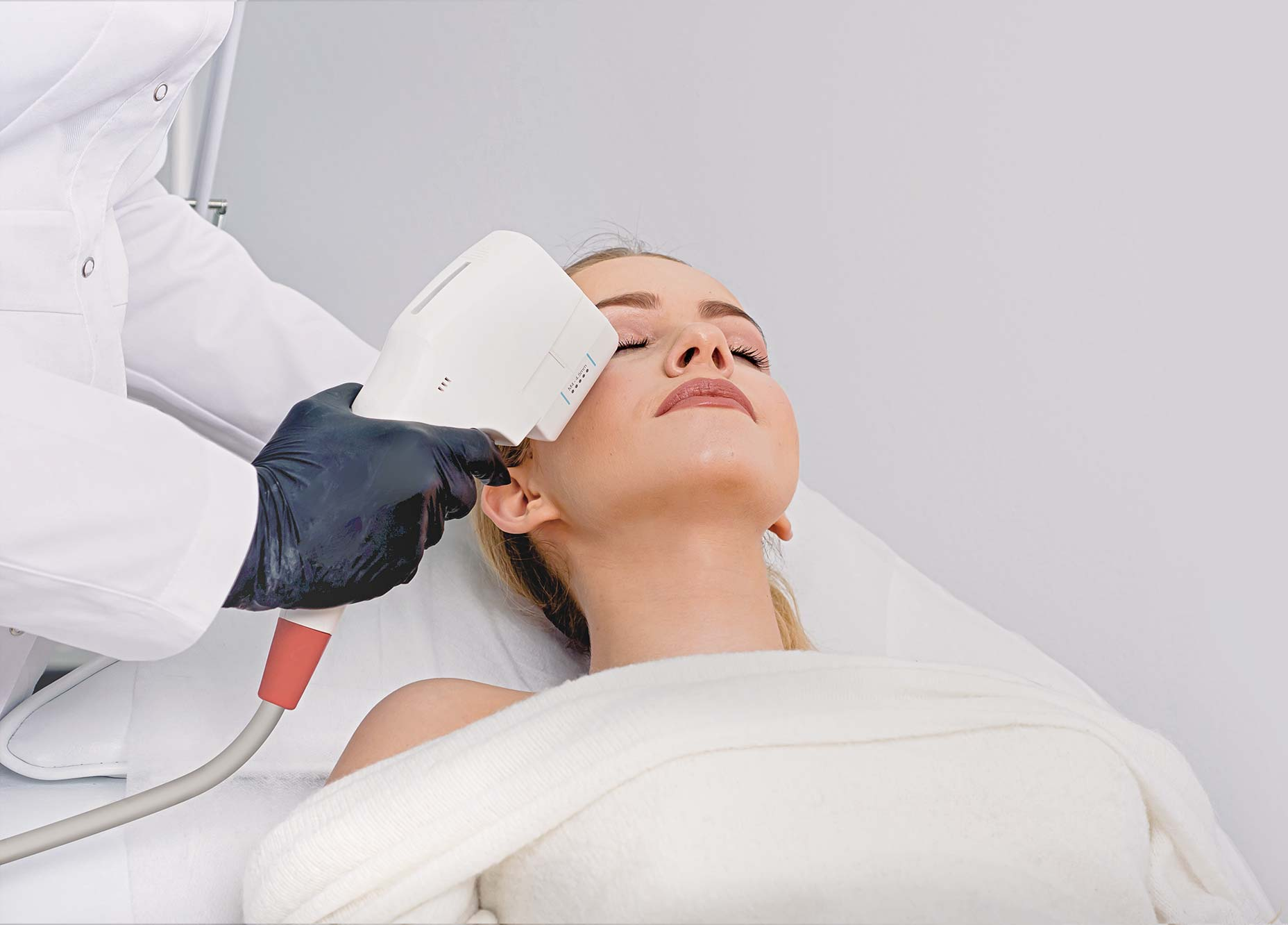 Attractive woman receiving skin treatment