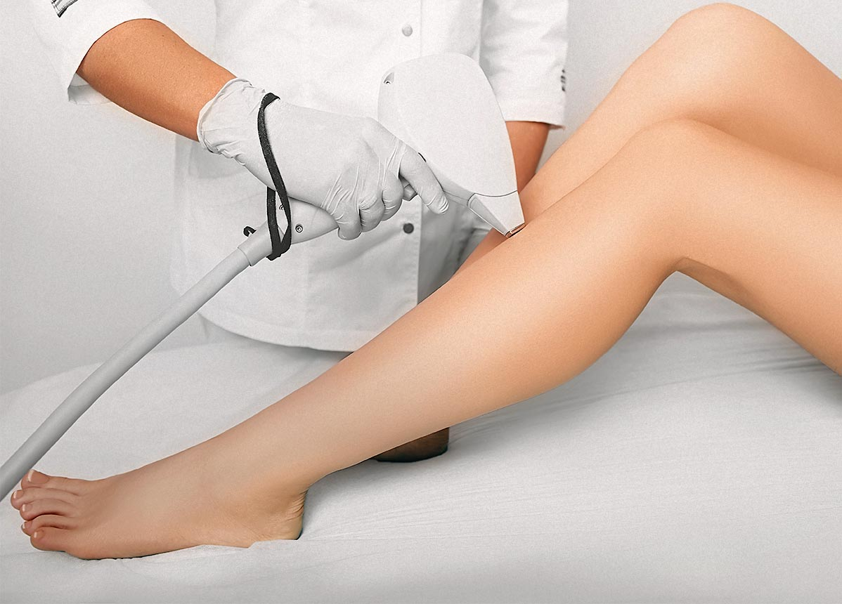 Woman's legs receiving laser hair removal