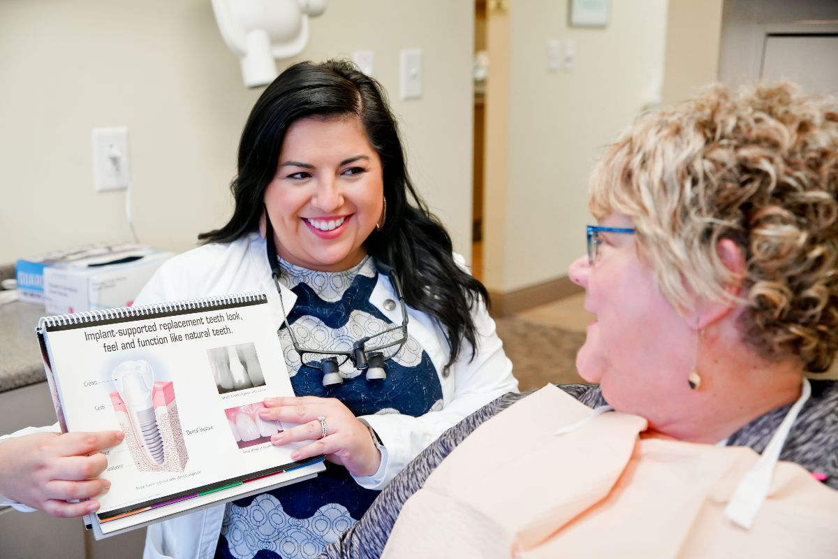 doctor explaining dental implants