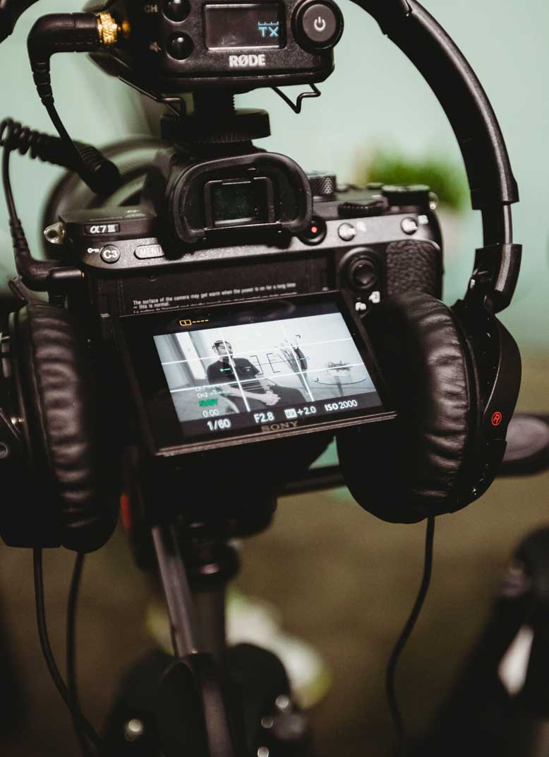 Photo of a video camera and headphones