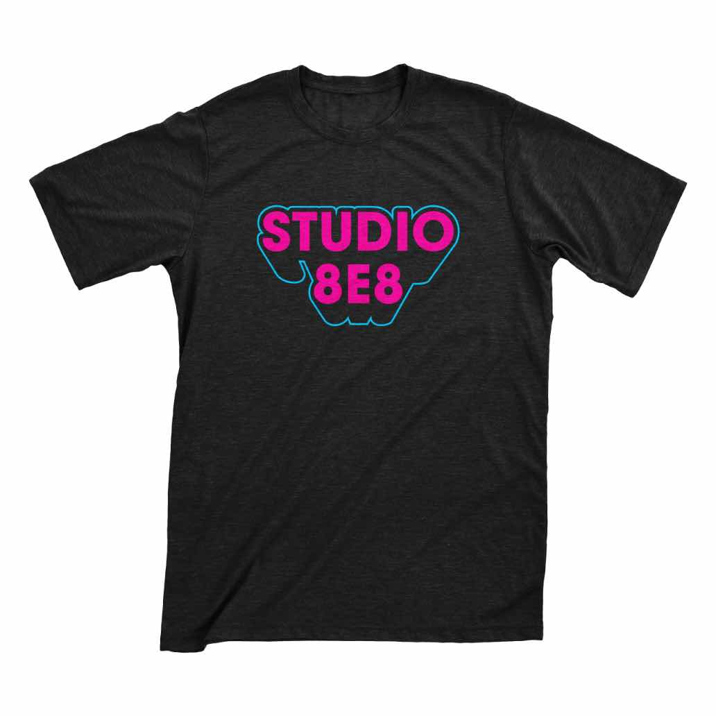 A dark gray shirt with Studio 8E8 printed on it in pink letters with a blue outline
