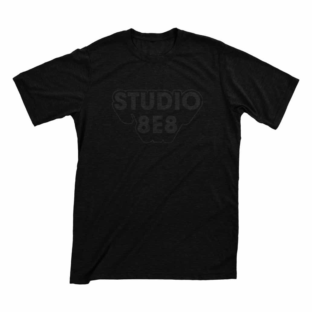 A black shirt with Studio 8E8 printed in dark gray letters