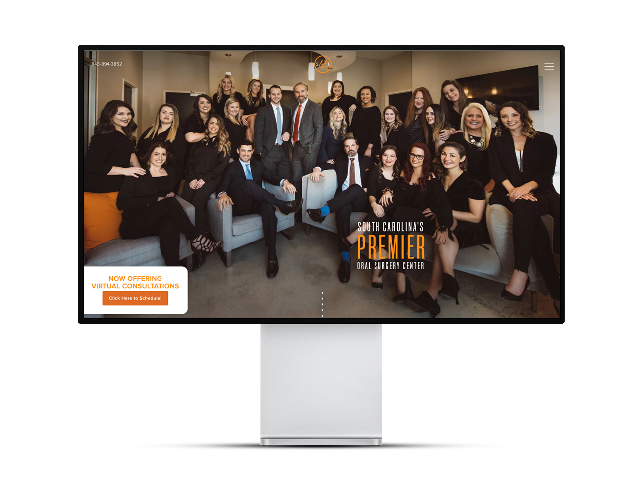 """Photo of Shelbourne & Associates homepage, showing a large team photo and text that says, """"South Carolina's Premier Oral Surgery Center"""""""