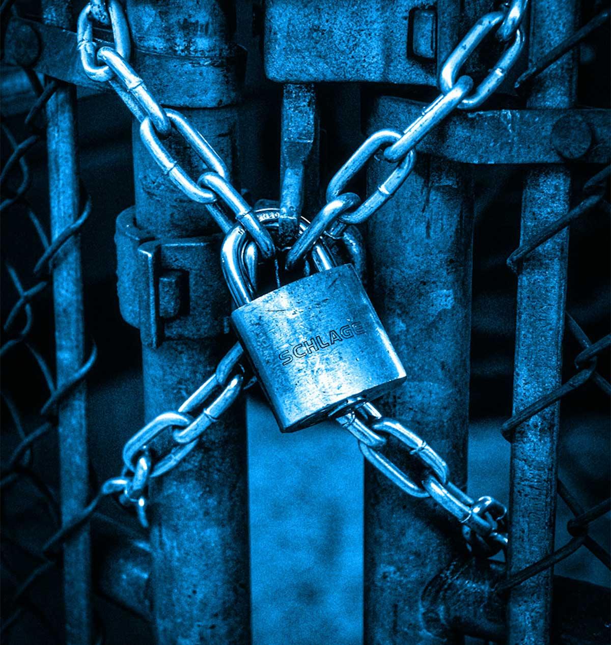 padlock across a fence