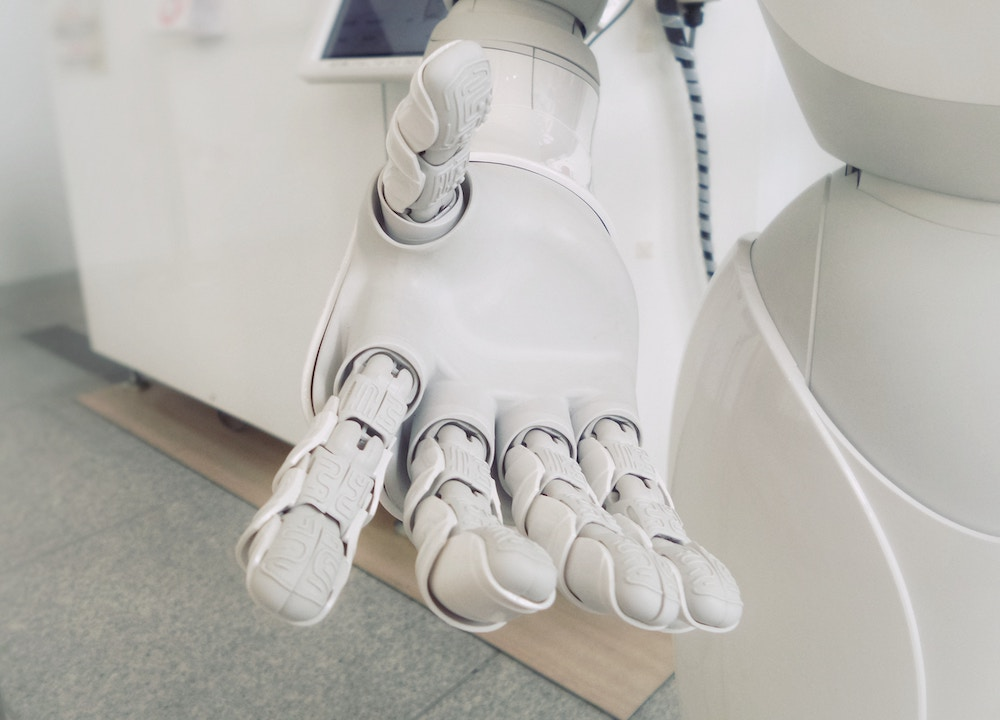 a robotic arm reaching out to hold your hand