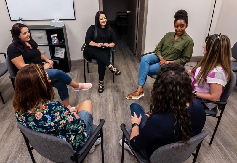 A group of female patients discuss during a group therapy session at Travco Behavoral Health in Warren, Ohio