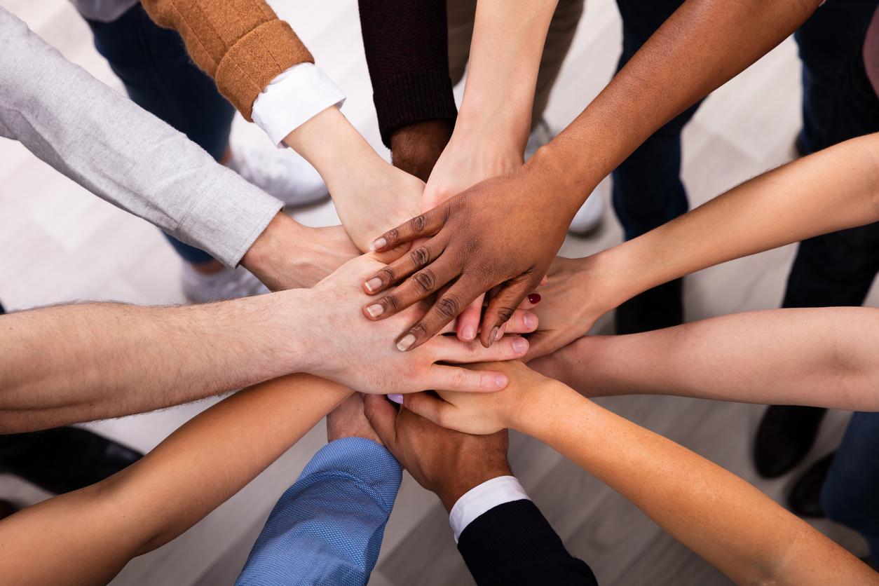 Hands in a circle showing teamwork