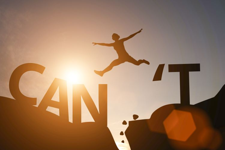 Silhouette of person jumping between the word can and the letter t