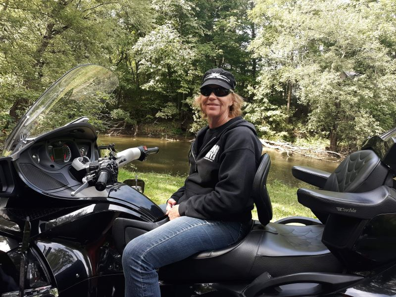 Tammy C sitting on motorcycle