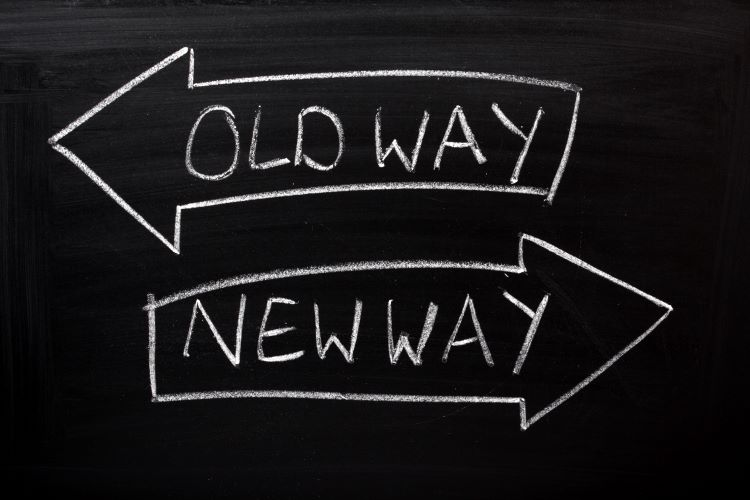 Chalkboard with one arrow pointing to old way and one pointing to new way