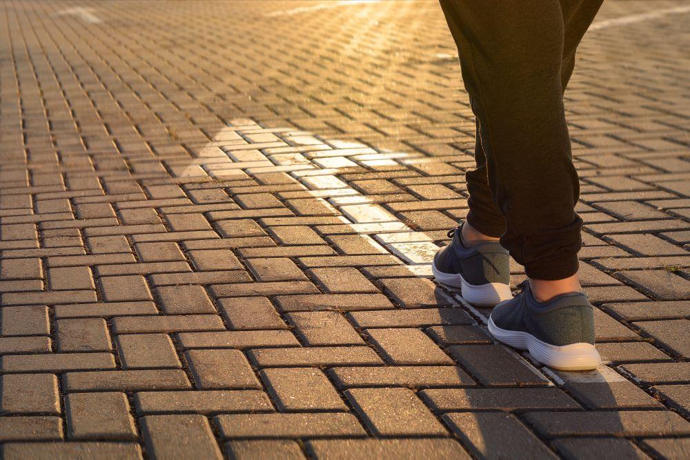 Feet walking to follow arrow