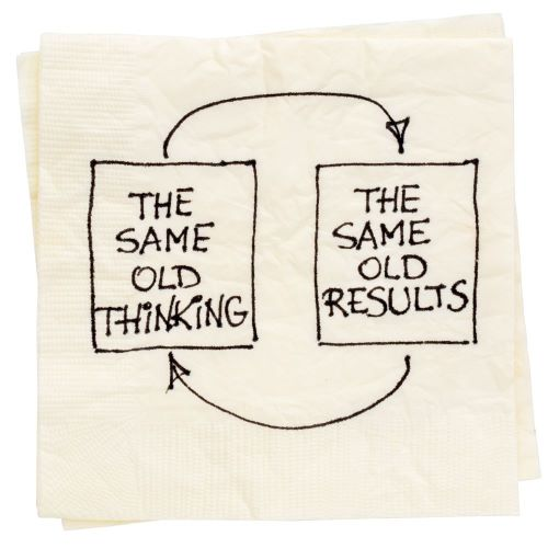 """Text """"The same old thinking leads to the same old results"""" written on a napkin"""