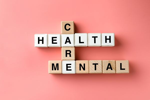 """Letter tiles spell """"mental,"""" """"health,"""" and """"care"""""""