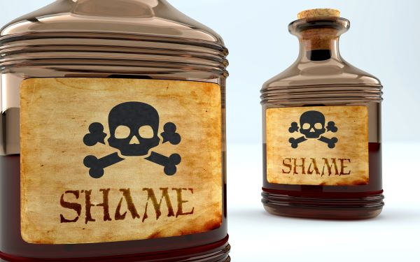 Dangers and harms of shame pictured as a poison bottle with word shame