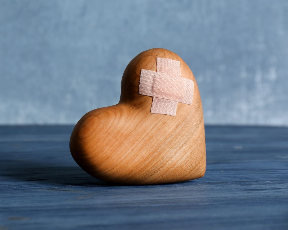 Wooden heart with bandaid