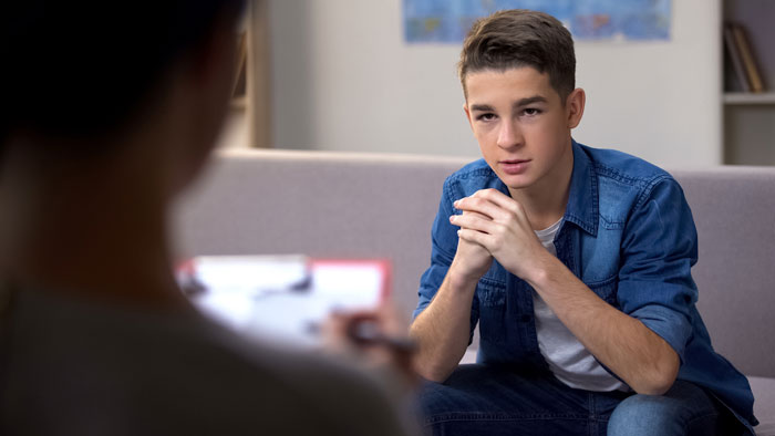 Teen boy in therapy for behavioral health