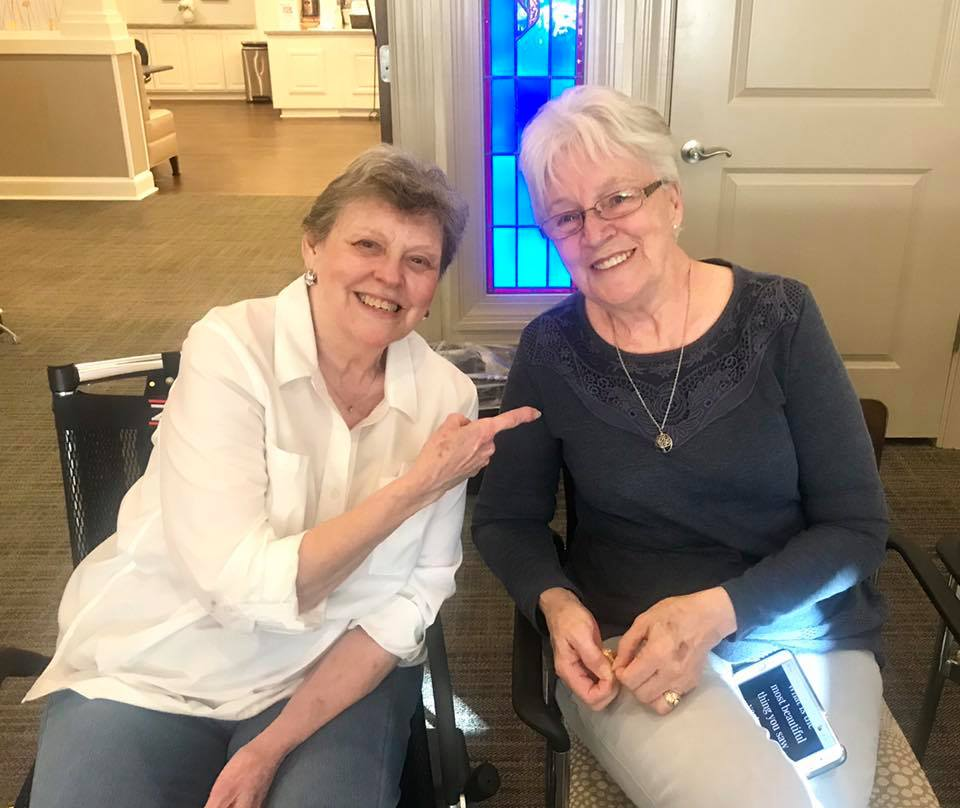 Two female Arbor Oaks residents smiling