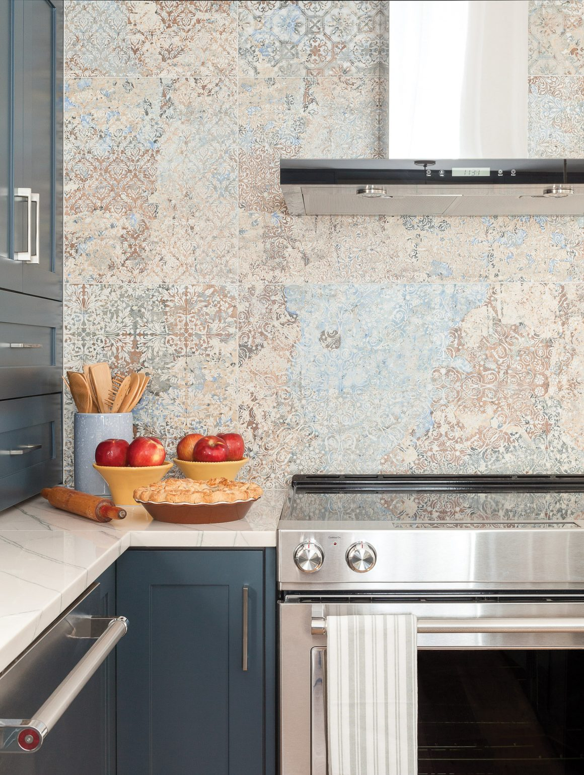 Blue kitchen, stove and backsplash