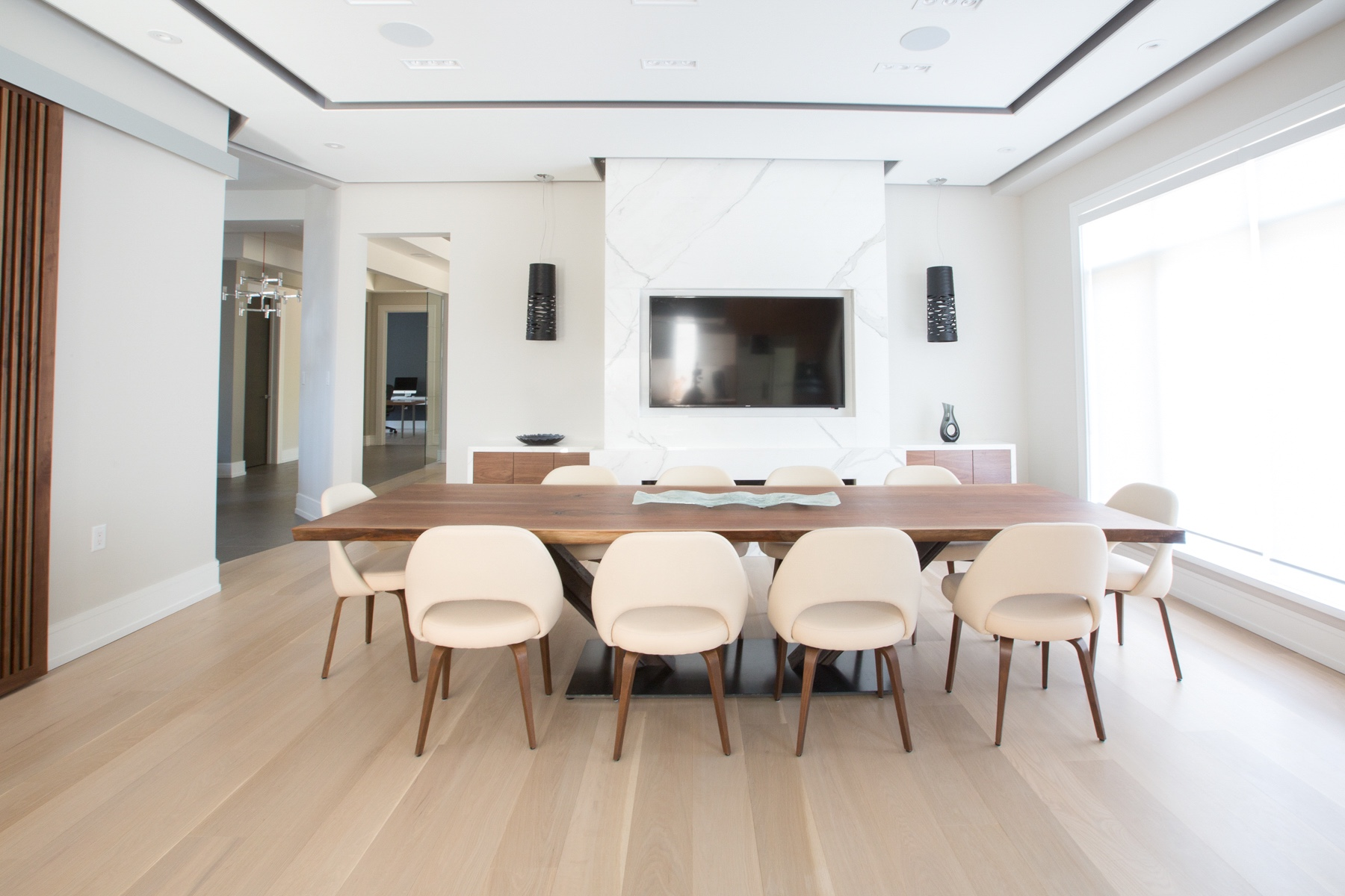 Wood dining table with white chairs