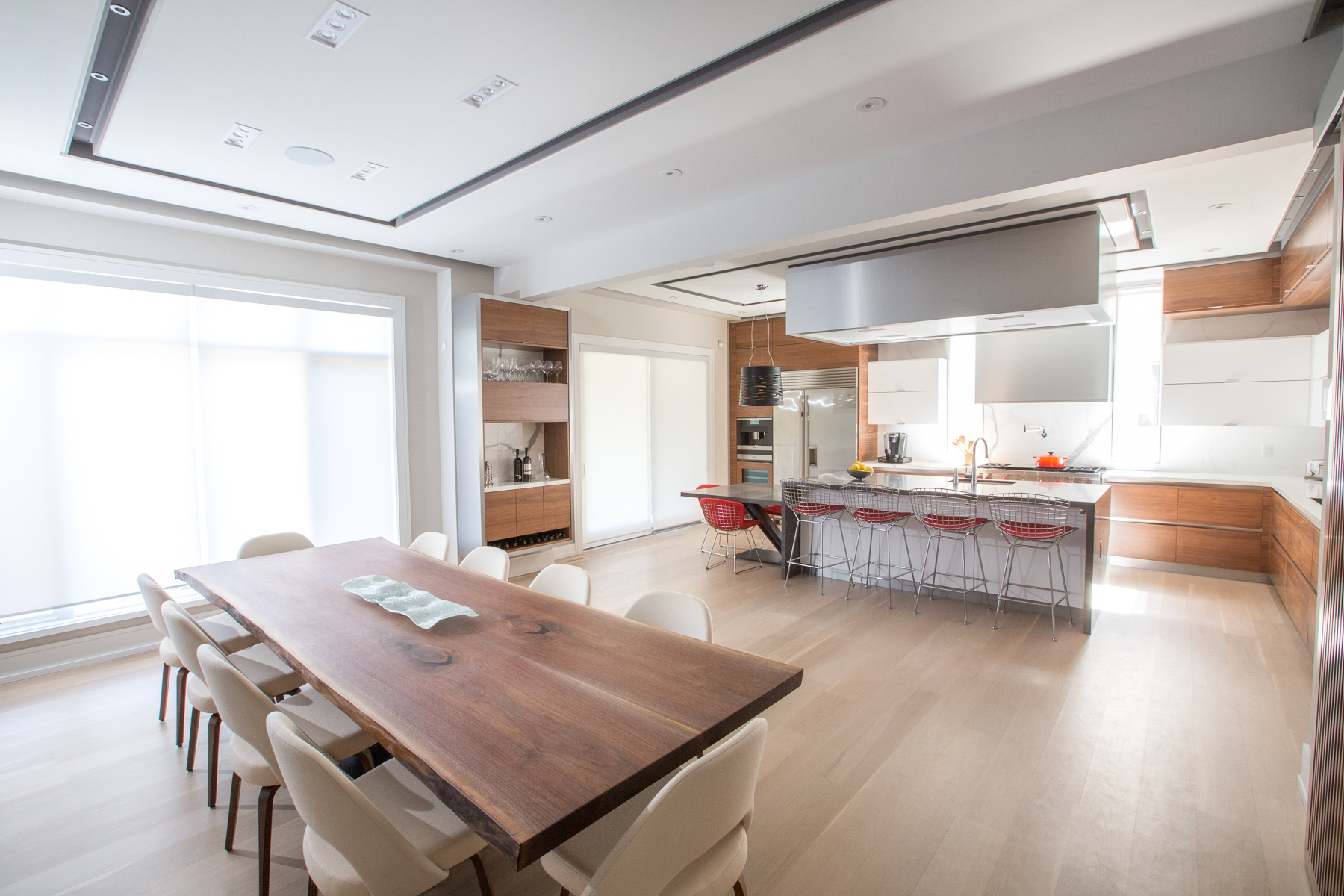 Wood dining table with kitchen in background