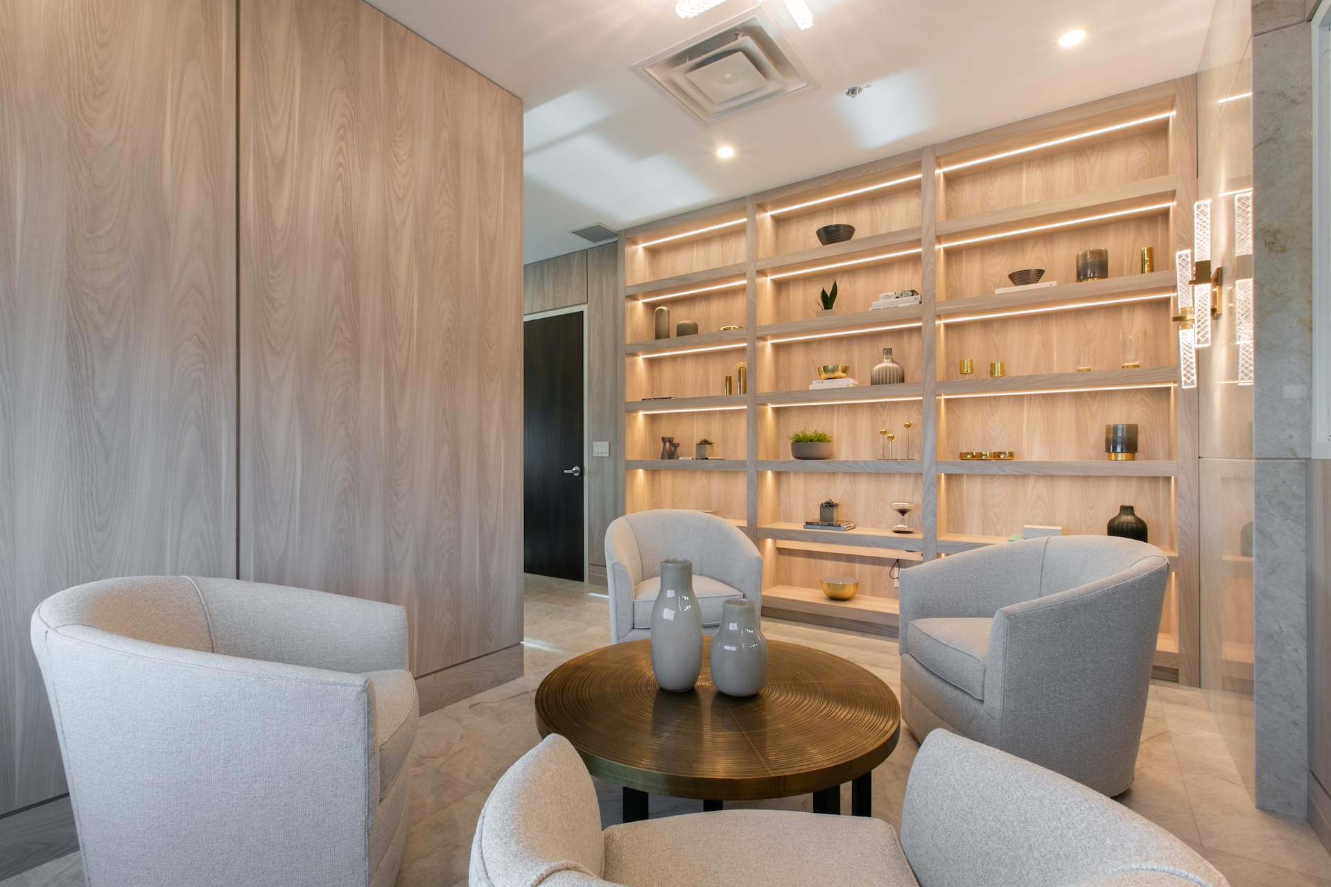 Table, chairs and wood wall shelves