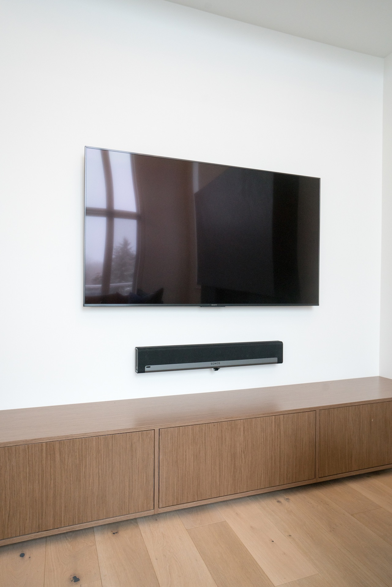 TV mounted on wall with wood
