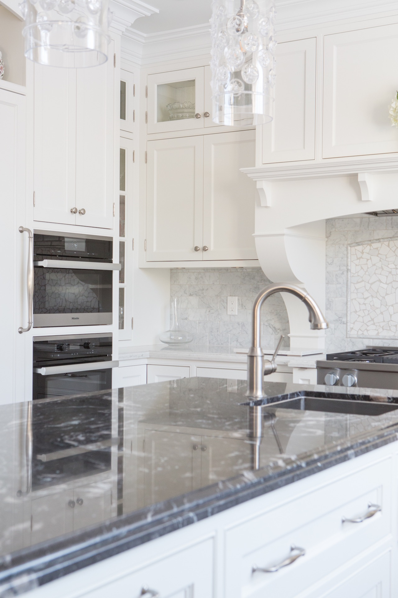 white and black island with sink