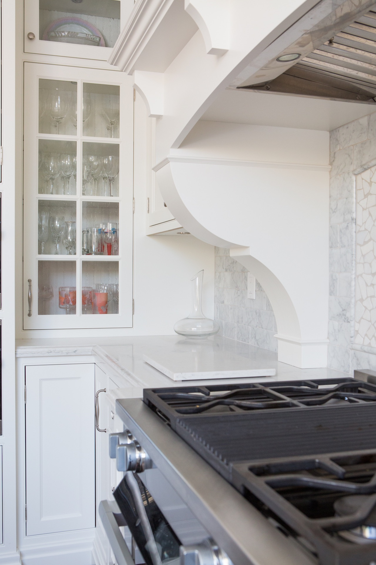 stove top and white cabinets