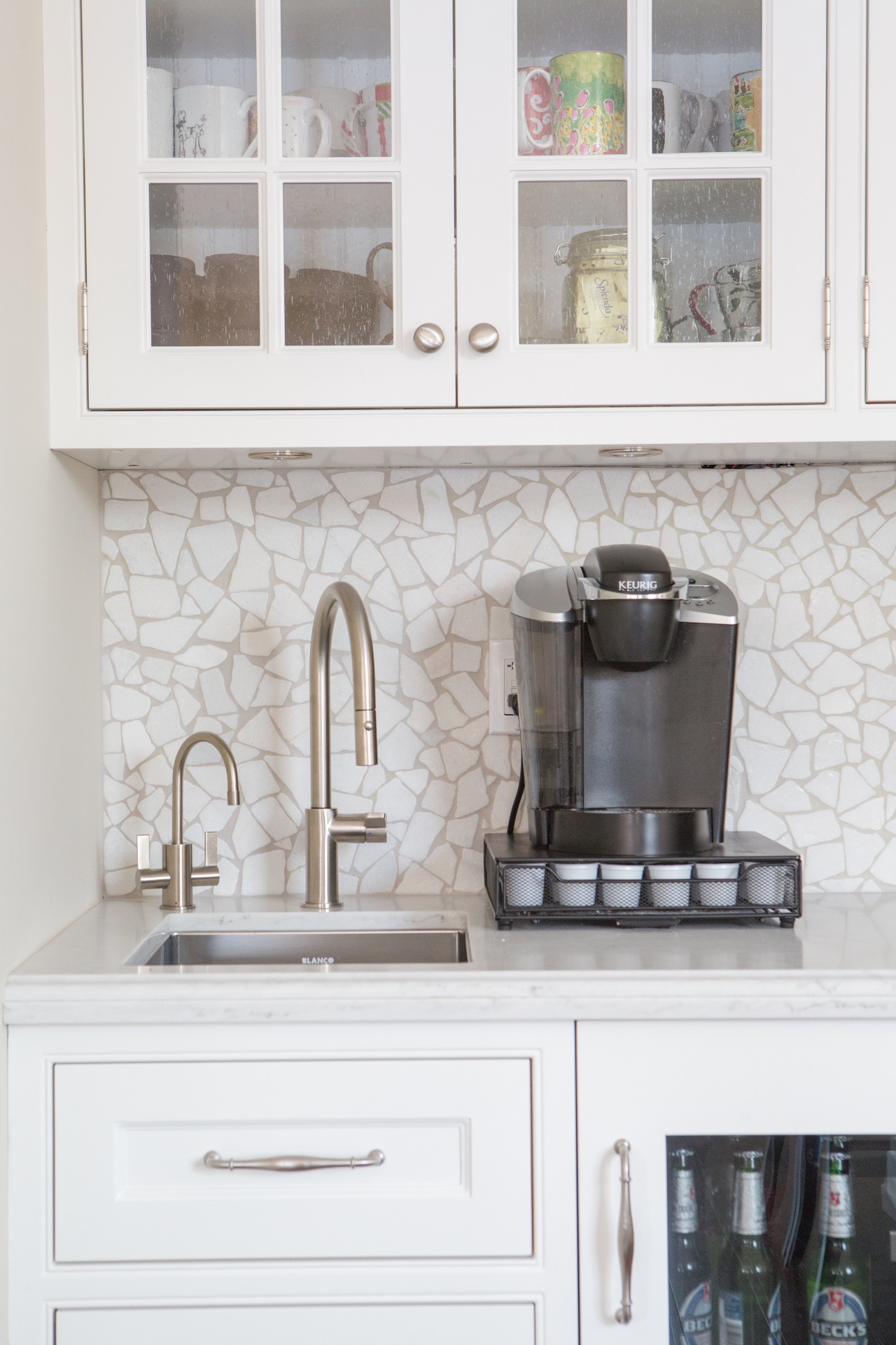 white cabinets with espresso machine