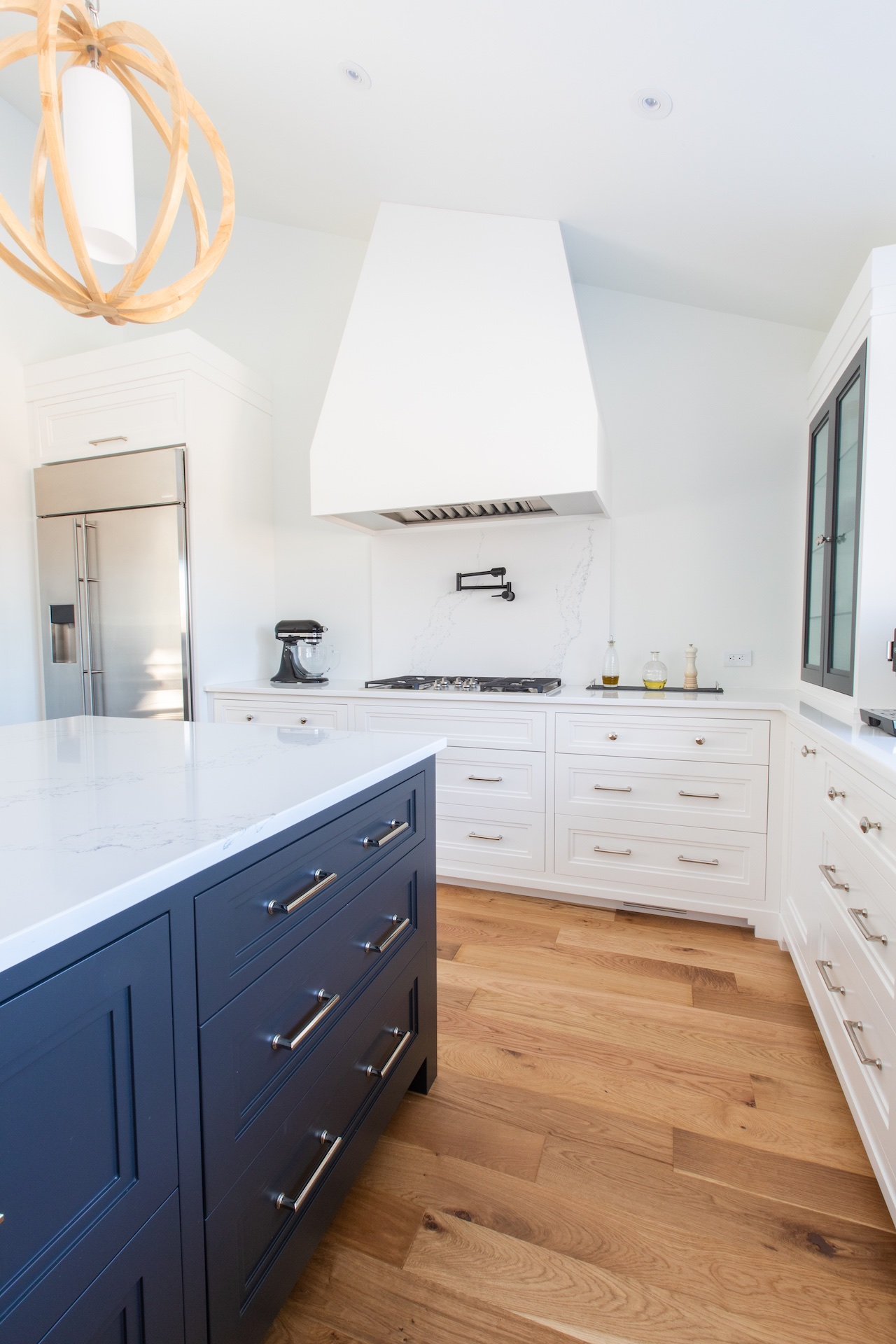 blue island and white kitchen with stove