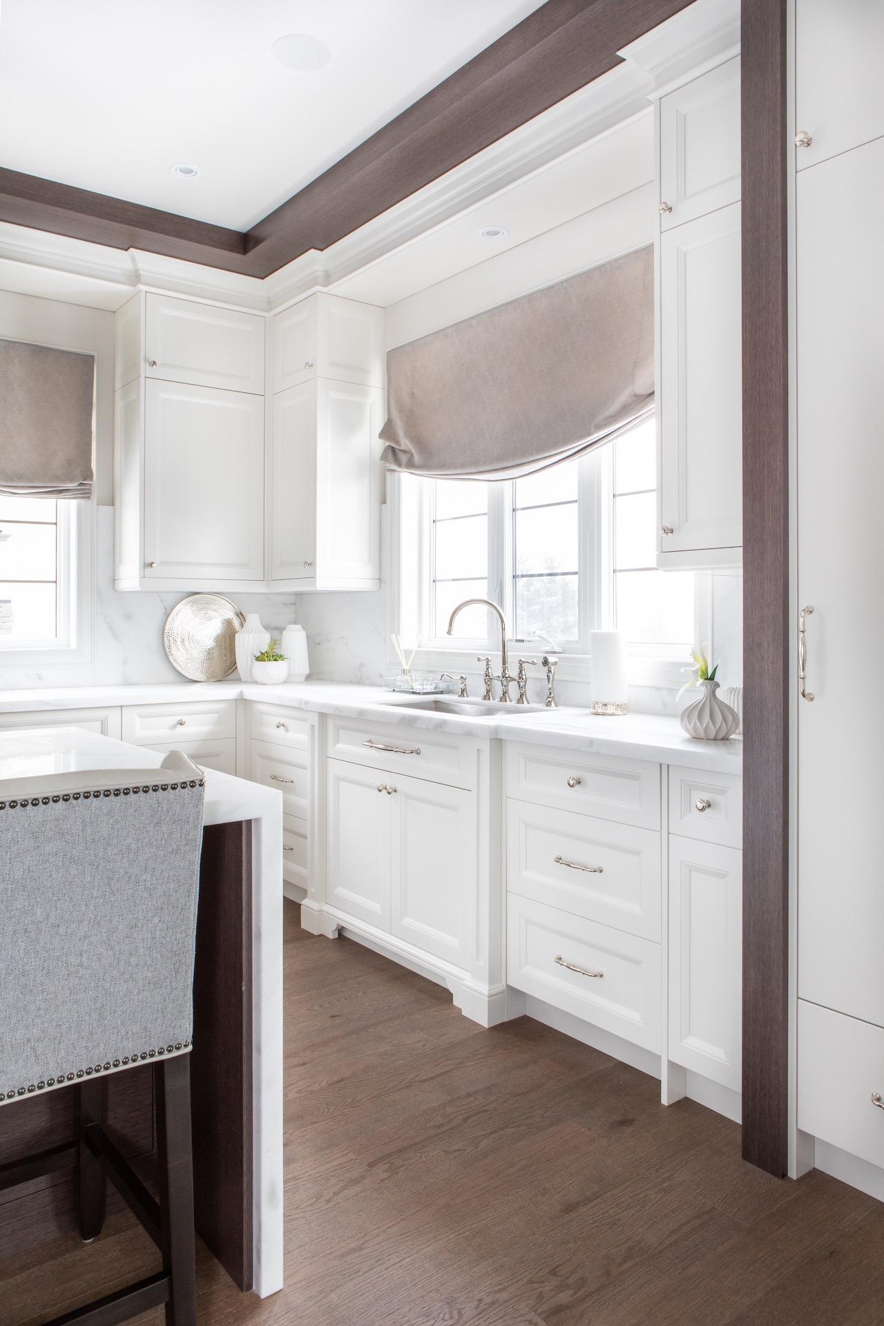 White NIICO kitchen with sink under window