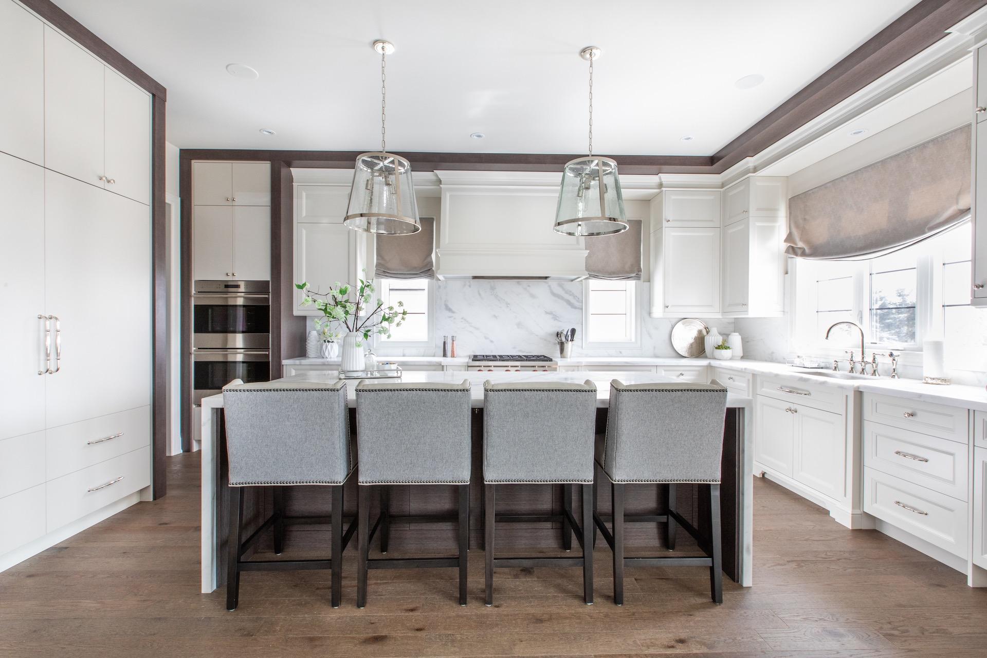 White NIICO kitchen with grey bar stools