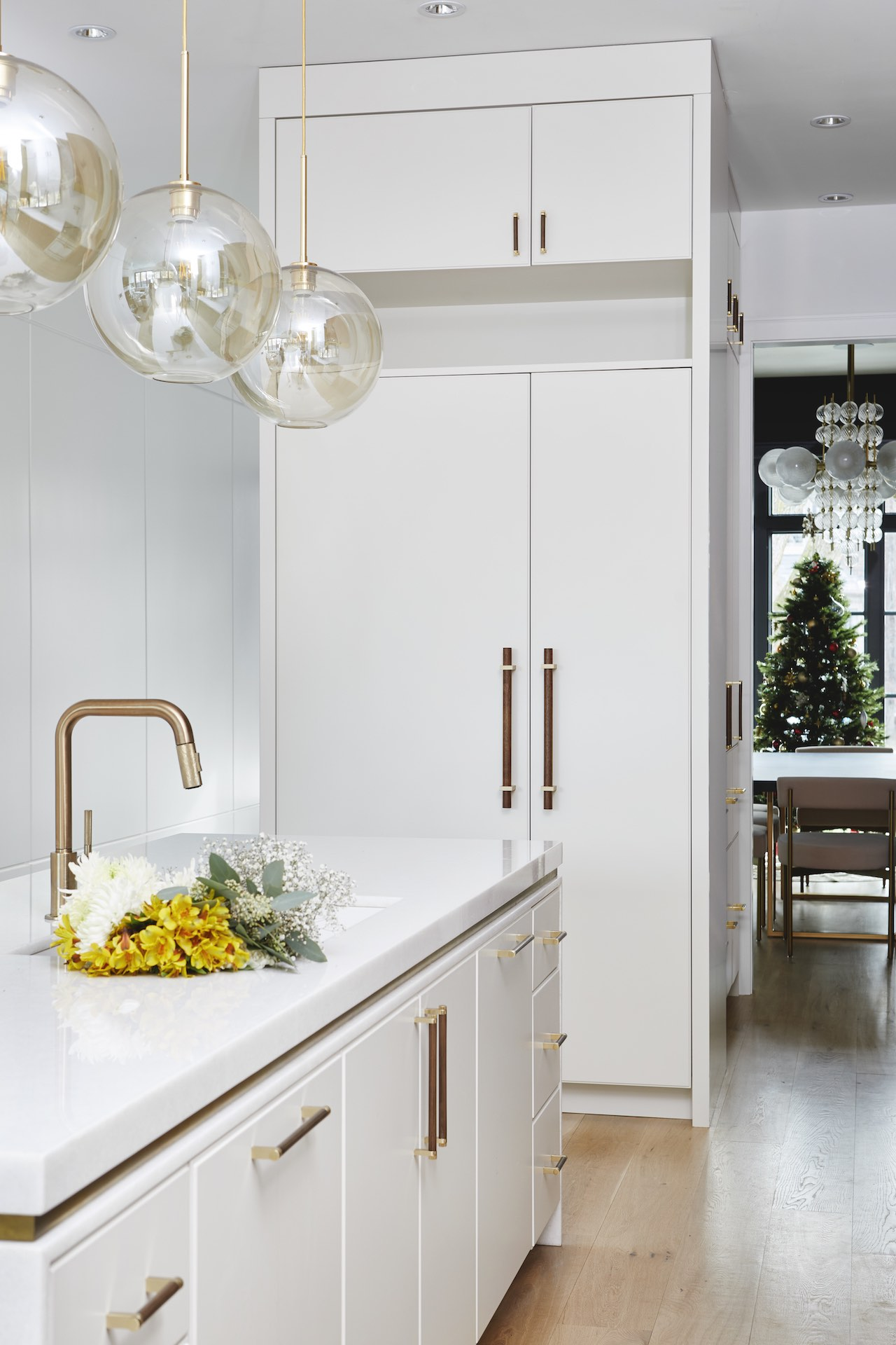 white kitchen island and gold sink
