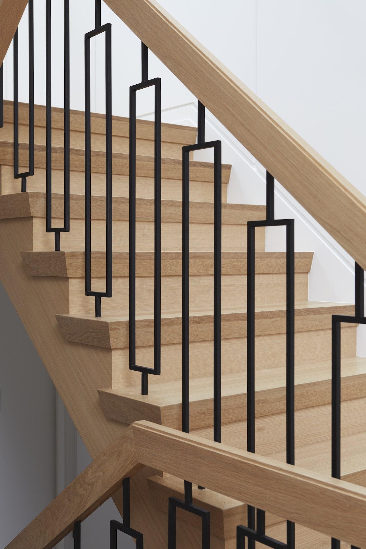 wood stairs and black railings