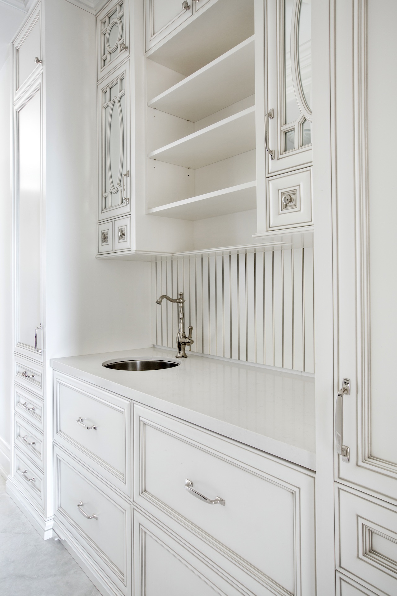 white kitchen cabinets with sink